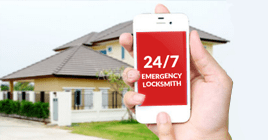 person calling emergency locksmith
